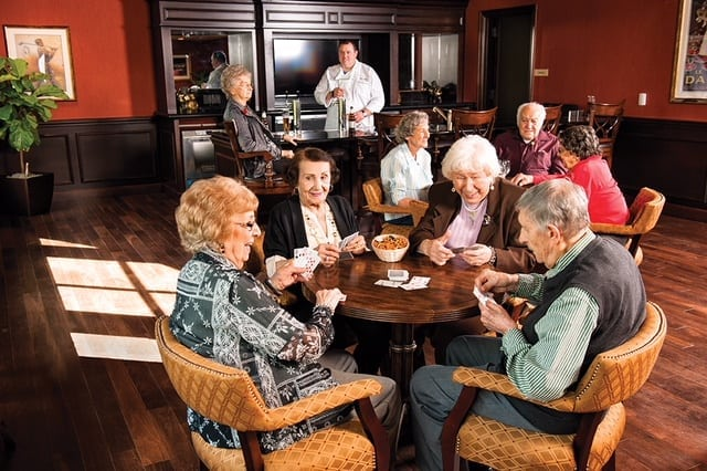 Photo: Seniors gathered around bistro table Brandywine Living Advertorial