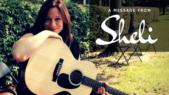 "Graphic: Photo of Sheli Monacchio holding a guitar. Reads ""A MESSAGE FROM SHeli"""