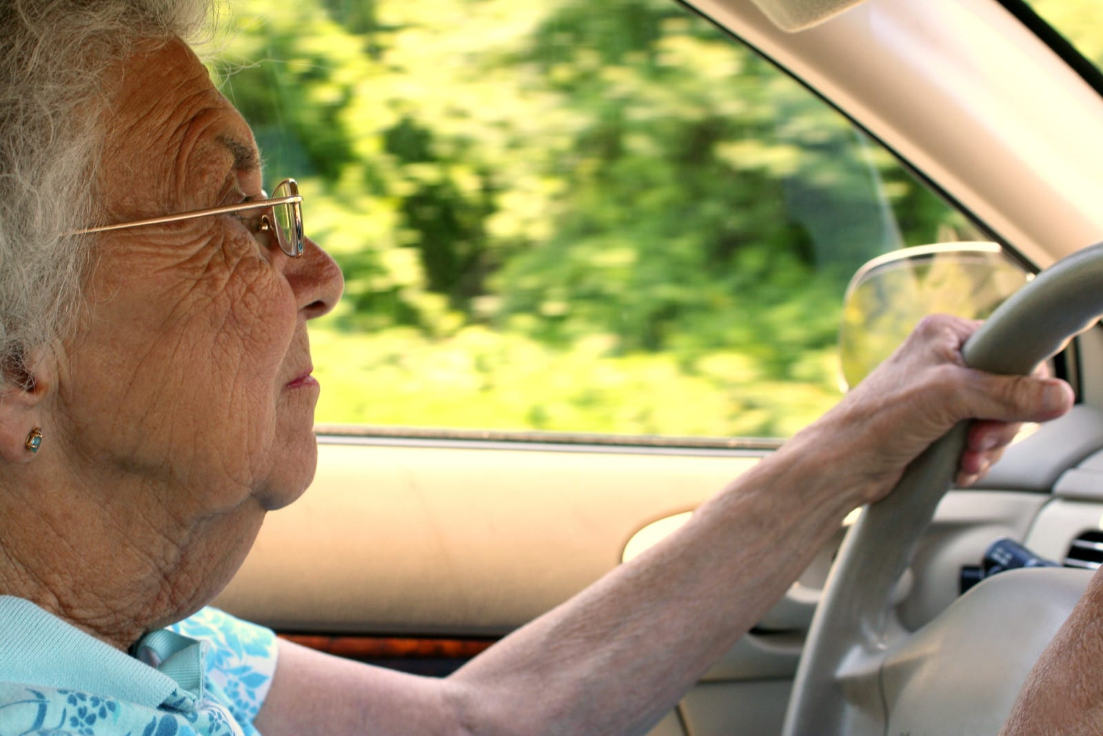 Photo: Older woman driving