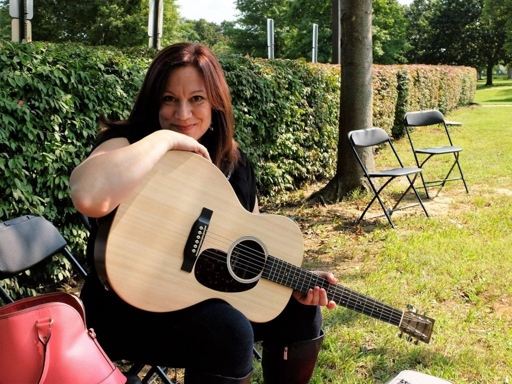 Photo: Sheli Monacchio, of Caring Connections of New Jersey, with a guitar